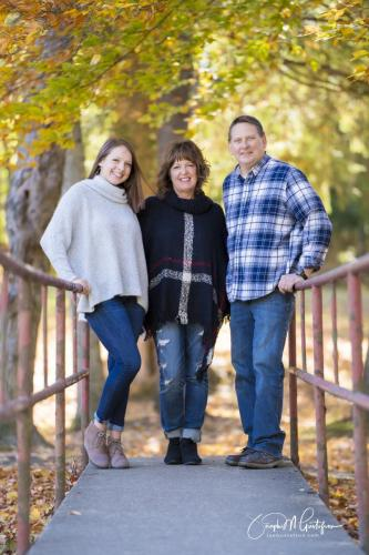 Family photo on bridge in fall