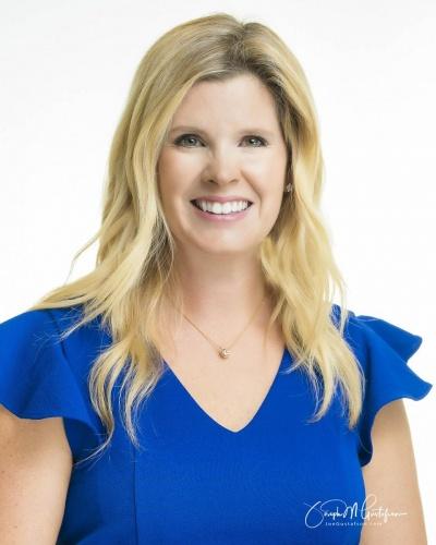 Corporate headshot white background blond woman