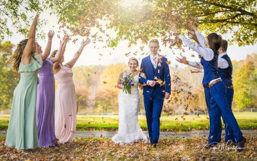Awesome wedding photo wedding party throwing leaves
